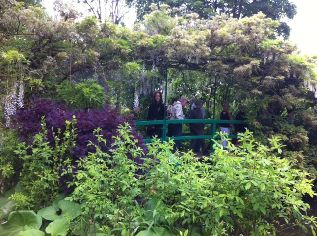 Standing on the famous water lily bridge at Giverny